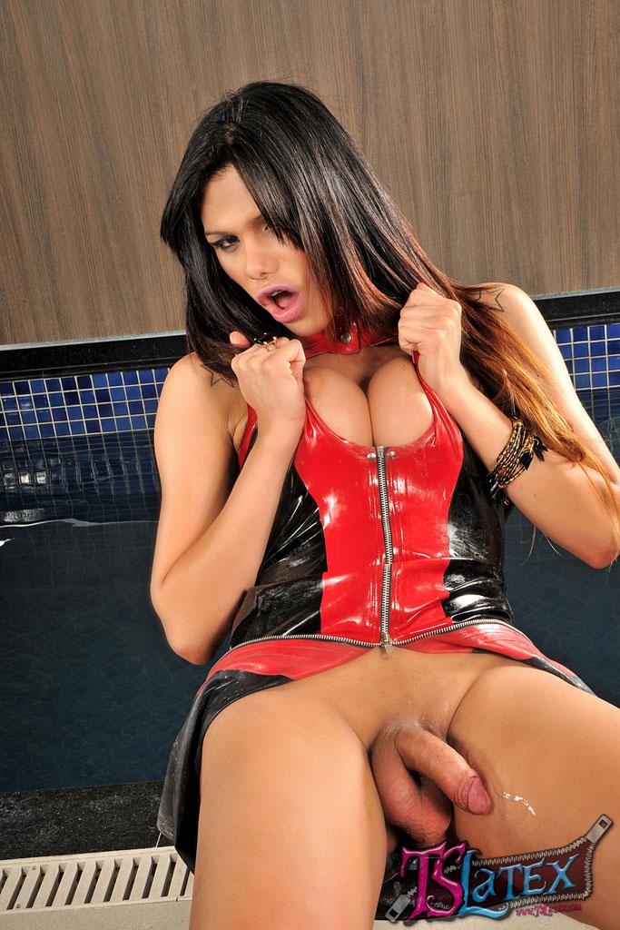 Shemale Marina Almeida stroking in black Latex