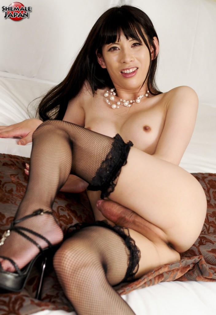 Japanese Shemale posing in black Lingerie and Fishnet Stockings